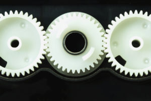 White plastic gear components of the printer.